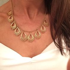 NWOT gold necklace with drop down pendants NWOT Only worn for the photo! Simple yet eye catching delicate gold necklace. Light weight and totally fancy. Would pair well with both crew or v-neck style tops! Nine West Jewelry Necklaces