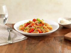 Barilla® Whole Grain Rotini with Cherry Tomatoes, Basil and Parmigiano Cheese - Try this step by step Barilla recipe for a delicious meal that you're sure to love.