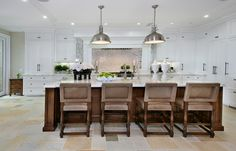 Love everything about this kitchen: the ceiling, big island, white cabinets, chairs, lighting. In love!