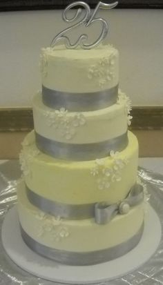 A 25th wedding anniversary cake. Feeds 100 people. $375.00