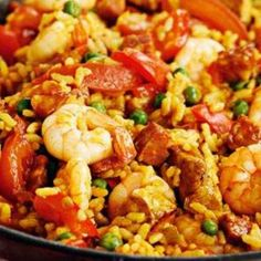 Paella - Paella is a traditional spanish rice based recipe. The rice is served mixed with sausage, chicken breast, shrimp, vegetables and pork knuckles flavoured broth  #Spanishfood #ricedish #foodporn #pealla #recipe #cooktube