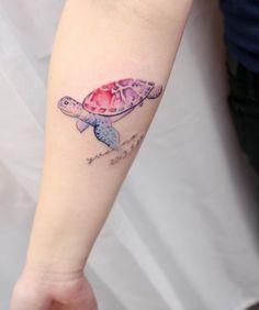 Beautiful sea turtle on forearm by Hello Tattoo