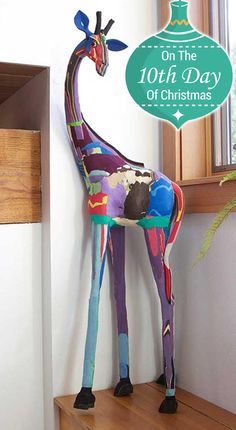 These tall giraffe sculptures are made from discarded flip flops that have been hand-formed, carved, and cemented together by artisans in Kenya. #fairtrade #handmade #holidayshopping #africangifts #wintershopping #holidaygifts #recycled #swahilimodern