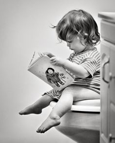Oh how refreshing, a child with a book. A young mind getting ready for a life time of education