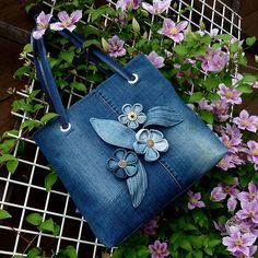 Recycled denim jean designed handbag with denim flowers