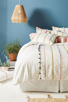 A duvet is great for switching out with the seasons + gives your bed a luxurious feel.