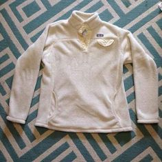 Patagonia Bought this from another user and decided I didn't like it. It is a girls XXL but it fits like a women's XS/S. When I bought it, there was a stain on the inside of the pocket from chapstick. It it not noticeable when worn because it is on the inside of the pocket. There is also a small tear by the button that I was not told about, however you can't notice it. This is why I am selling it for cheap! It needs a new home with someone who can fix it! Patagonia Jackets & Coats