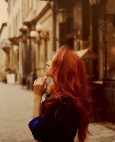 Amazing bright orange red hair color,focus of the street~