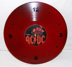 Hey, I found this really awesome Etsy listing at https://www.etsy.com/listing/129893832/acdc-red-painted-vinyl-record-wall-clock