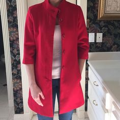 Red Coat Red coat with 3/4 length sleeves. Has pockets. Buttons up the front Tulle Jackets & Coats