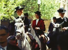 April 1966 - Jackie and her hostess, the Duchess of Alba, riding in a parade in Seville, Spain