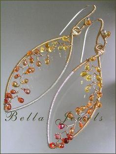 Modern Lines and Sparks...Mixed Metal Leaf Framed Golden Orange Sapphire Vine Almond Signature Original Earrings. $248.00, via Etsy.
