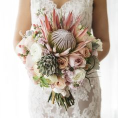 It's the moment we've all been waiting for. Profesh shots of the most liked, most regrammed, most talked about bouquet in Mary Mary history. We couldn't be more in love with this gorgeous shot of @penelope_and_co_melb's stunning king protea bouquet, captured by @ashleykweddingphotographer. Happy 6 month anniversary for last Sunday Penelope & John! xx #penjohn101015 #bridalbouquet #weddingbouquet #kingprotea #weddingflowers #melbourneflorist #iknowagirlthatdoesflowers #marymarystudio