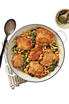 Crispy Chicken Thighs with Pasta and Pesto - Quick-Fix Chicken Suppers - Southernliving. Recipe:Crispy Chicken Thighs with Pasta and Pesto  Ready in 45 Minutes:This stovetop-to-oven method yields crisp, dark-golden skin and juicy, tender meat.