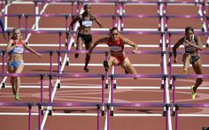 United States' Lolo Jones leads the field in a heat of women's 100-meter hurdles during the athletics in the Olympic Stadium at the 2012 Summer Olympics, London, Monday, Aug. 6, 2012.