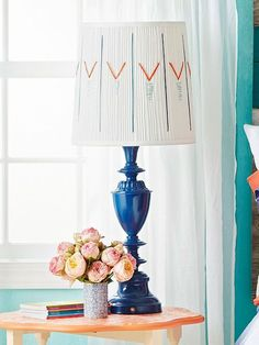 Vamp up a plain, white lampshade with embroidery floss.