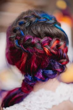 This bride matches her dress to her rainbow hair.