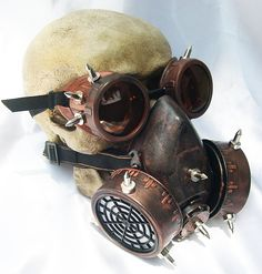 2 pc. set of Copper/Rust Distressed Look Steampunk Double Filter Respirator GAS MASK and Matching GOGGLES with Spikes- Burning Man Must Have. $74.50, via Etsy.