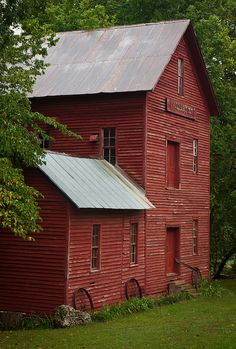 .red step roof barn