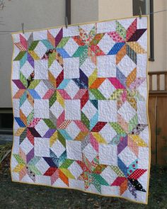 I love the layering of visual interest- yje star f;ower. tje white squares amd the white diamonds.   City House Studio: Starflower Quilt - the link to the tutorial is included. Love this quilt.