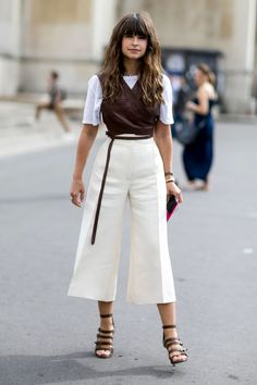 Miroslava Duma | leather wrap vest layered over a tee with culottes and strappy sandals