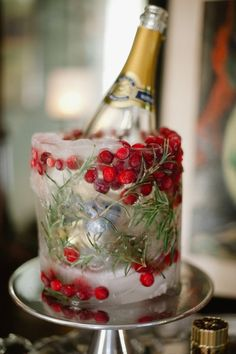 Ice is nice - especially if turned into a stunning wine bucket for your holiday champagne. Locate a small container (be sure your wine bottle will fit inside) and a larger one. Insert the small can inside the larger one. Add pine and colorful berries. Fill with water and freeze. When ready to impress, remove the frozen cylinder and place your favorite wine bottle inside. Everyone will want to know how you did it!