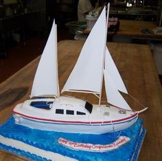 Kennedy's Sailboat This was another cake that I made at my part time job. It was for Congressman Patrick Kennedy's birthday. Pirate Boat Cake, Sailboat Cake, Full Sheet Cake, Sailing Party, 40th Birthday, Birthday Cakes, 3d Cakes, Part Time Jobs, Cakes For Boys