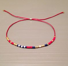red string bracelet friendship bracelet Bracelet is made of a Miyuki Delica beads and silk thread.This handmade bracelet is adjustable. One size Jewelry Stores, Diy Jewelry, Beaded Jewelry, Jewelry Box, Jewelery, Handmade Jewelry, Jewelry Making, Beaded Bracelets, Bracelet Making