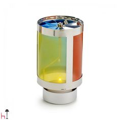 Girachille by Design Memorabilia is a beautiful cylinder-shaped candle holder made of stainless steel and coloured PVC.