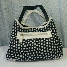 Ocaba Paris/Abaco Reversible Purse Such a unique fun. Some of the light leather is discolored as seen in picture 3 & 4. The first can be worn with the polka dot side with centers pulled in or left out. Or can be flipped do you have the black side showing with white accents and the center pulled in or left out. The brand is sometimes known as OCABA Paris and that's what's shown on the inside of the purse. The formal name does read ABACO Made in France. Ocaba Paris/ Abaco Bags Shoulder Bags