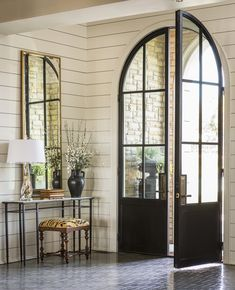 CASEY SARKIN INTERIOR DESIGN Arched Front Door, Front Door Entryway, Iron Front Door, Entryway Console, Arched Doors, Entrance Foyer, Glass Front Door, House Entrance, Console Tables