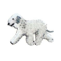 MADE-TO-ORDER: One beaded Bedlington Terrier pin pendant. This piece was created by stitching tiny glass seed beads to felt (2-3 beads at a time) using a strong nylon thread. The stitching technique used is what gives this pooch her texture & dimension. Six different shades of seed beads were used, as well as a tiny glass taxidermy eye for her nose. A 1 (2.5cm) pin/pendant finding is sewn to the back. Piece is backed with Ultrasuede and signed by The Lone Beader. This is a unique gift idea…