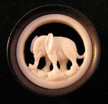 hand carved ear gauges in an elephant motif made from organic bone and wood