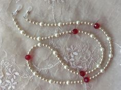 Beautiful siam red crystal and pearl eyewear chain by arepaki.etsy.com $19.00