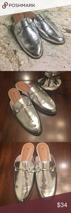 Metallic Silver Slides size 6.5 Restricted Metallic silver mile slides size 6 1/2. Brand new with out tags. The hottest trend this season. These shoes are so fun and surprisingly versatile as well as comfortable. Restricted Shoes Flats & Loafers