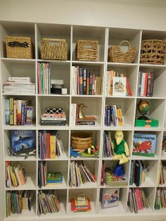 Amber B Interiors, shelf styling, baskets on shelves, kid spaces, basement, organizing books