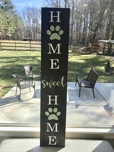 "The perfect large front porch sign to welcome guests to your home! Approximately 48""x10"" Stain: Ebony Lettering: White Paw Print & Sweet: Mint Green (#9) Sealed & protected for the outdoors! •All wood designs are handcrafted from 100% wood pine, markings and texture will vary"