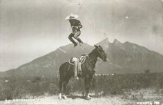 Charro rope stunt with Monterrey, Mexico Saddleback Mountain the background.