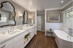 Contemporary bathroom design with creative mirrors and hardwood floors