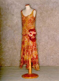 Beaded printed silk chiffon dress with faux flowers, probably European, 1930. Tirelli Trappetti Foundation.