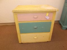 $149 - Primitive 3 drawer chest - shabby yellow paint on cabinet with multicolor drawer faces. ***** In Booth A8 at Main Street Antique Mall 7260 E Main St (east of Power RD on MAIN STREET) Mesa Az 85207 **** Open 7 days a week 10:00AM-5:30PM **** Call for more information 480 924 1122 **** We Accept cash, debit, VISA, MasterCard or Discover.