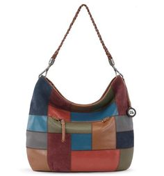 Consider the Multi Patch hobo for your new arm candy. Our Indio Hobo offers plenty of space to stow your essentials throughout the day while its exterior adds beautiful textural details of multi-colored leather and suede patches put together with zigzag stitching, subtly tapping into the vintage and 70s trend.    My next bag!  Fall-2016!