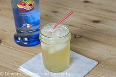 Sparkling Tropical Lemonade  (2 oz Tropical Punch Vodka  6 oz Lemonade  Splash of Sprite)