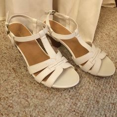 White heeled sandals White Croft&Barrow heeled sandals. Perfect for the Summer! They have never been worn, but there are small black smudges on the sides in a few areas (second picture) 2.5 inch heel Croft & Barrow Shoes Sandals