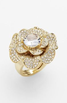 Dress up a LBD with a  sparkly flower cocktail ring.