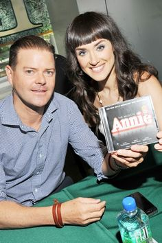 Clarke Thorell and Brynn O'Malley are ready to sign some ANNIE CDs.