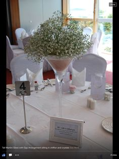Martini glass table centres with crystals and dusky pink fabric filled with gyp....stunning