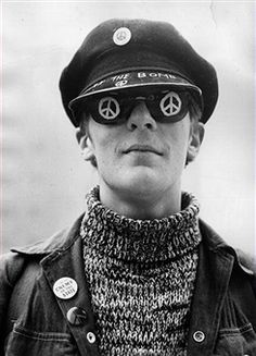 11th April 1966: A youth in a march organised by the Campaign for Nuclear Disarmament is wearing sunglasses painted with the CND logo. (Photo by Keystone/Getty Images)