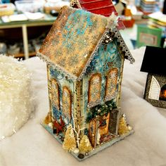 Link to 20 Paper Houses. I repined this from http://www.capadiadesign.com/2011/12/little-holiday-houses.html