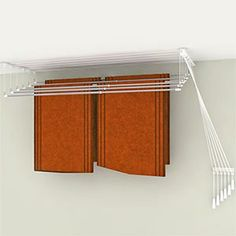 Ceiling-mounted laundry drying rack (decrease your carbon footprint and it's easier on your clothes).  By Greenway Home Products.